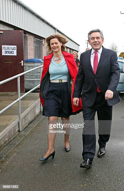 Gordon Brown UK prime minister and leader of the Labour party right and his wife Sarah arrive to vote at the polling station in North Queensferry...