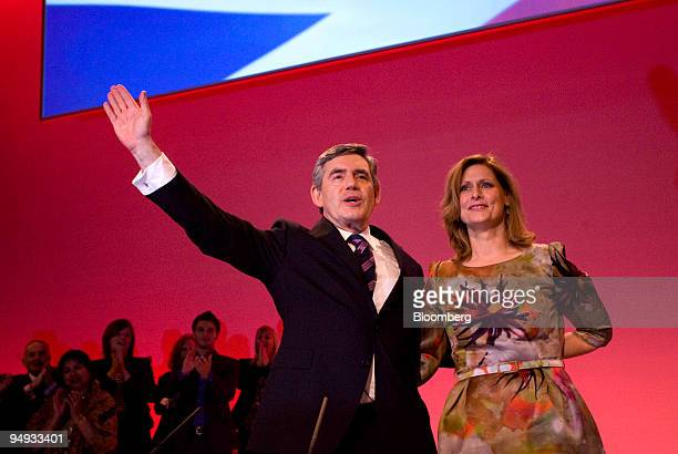 Gordon Brown UK prime minister left gestures as he stands with his wife Sarah after delivering his keynote speech at the Labour party conference in...