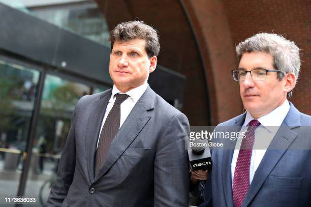 Gordon Caplan, left, leaves the John Joseph Moakley United States Courthouse in Boston after his sentencing in the college admissions scandal on Oct....