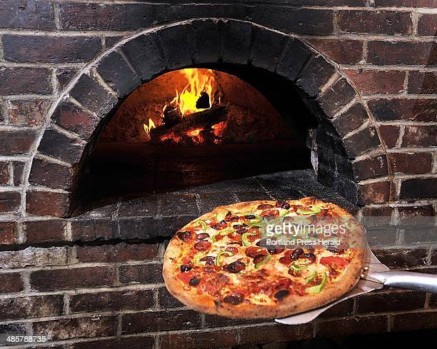 Gordon Chibroski Staff Photographer Friday May 20 2011 Dining Guide Art from Siano'a Pizzeria at corner of Stevens and Brentwood A fresh pizza is...