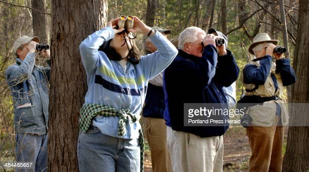 Gordon Chibroski/Staff PhotograpHer Monday May 08 2007 Bird watching in Evergreen Cemetery Here Diane Weinstein of South Portland views to the sight...