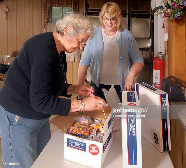 Gordon Chibroski/Staff Photographer On Monday July 30 2007 a group at Faith United Methodist Church in Orr's Island pack sundry boxes for adopted...