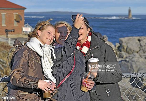 Gordon Chibroski/Staff Photographer Sonja Krakau of Cologne Germany a student at SMCC takes a picture of herself with Miriam Blum left and Elena...