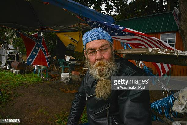 Gordon Corley sits outside his wife's biker apparel shop Mama J's on Tuesday March 3 in Maplesville AL This coming weekend marks the 50th anniversary...