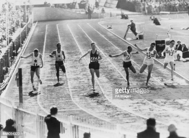 Gordon Day of South Africa winning the first semi final of the men's 220 yards Second was Stan Levenson of Canada with Keith Gardner of Jamaica...