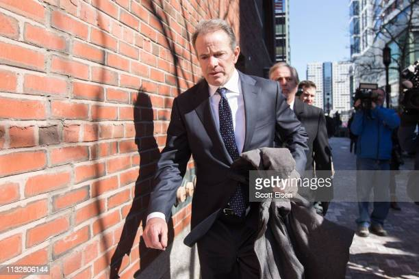 Gordon Ernst, former head coach of the men's and women's tennis teams at Georgetown University leaves following his arraignment at Boston Federal...