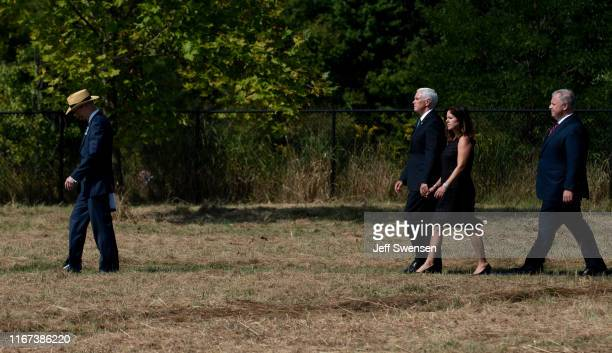 Gordon Felt president of the Families of Flight 93 leads US Vice President Mike Pence and his wife Karen to the crash site at the Flight 93 National...