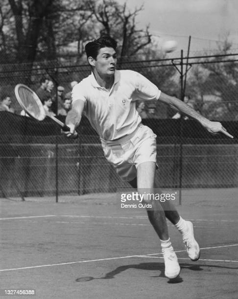 Gordon Forbes of South Africa keeps his eye on the tennis ball as he plays a forehand return to Geoffrey Bluett of Great Britain Connaught Club's...