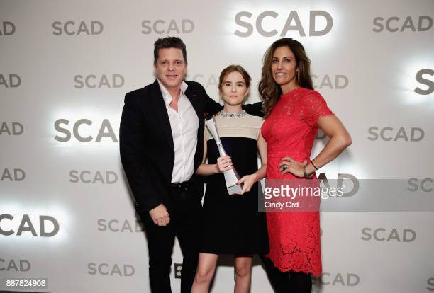 Gordon Gilbertson Gilbertson Entertainment actress Zoey Deutch and CAA agent Tracy Brennan pose with Rising Star Award backstage at Lucas Theatre...
