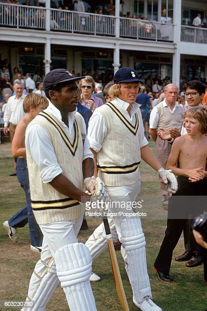 Gordon Greenidge and Barry Richards of Hampshire walk out to bat in the second innings of the County Championship match between Hampshire and...