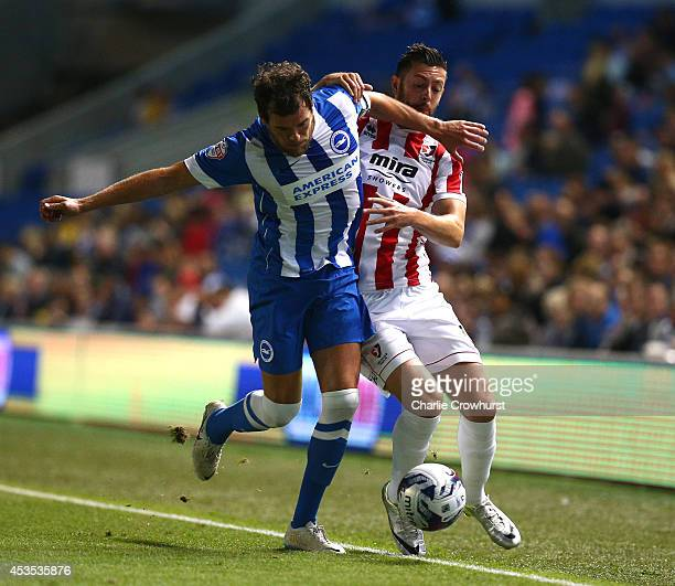 Gordon Greer of Brighton looks to get the better of Andy Haworth of Cheltenham during the Capital One Cup First Round match between Brighton Hove...