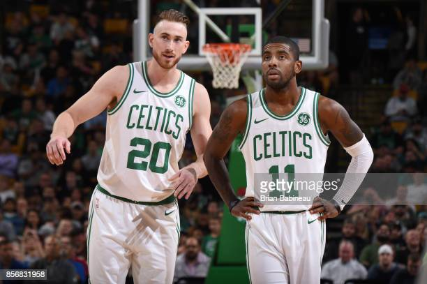 Gordon Hayward and Kyrie Irving of the Boston Celtics are seen during the game against the Charlotte Hornets during a preseason game on October 2...