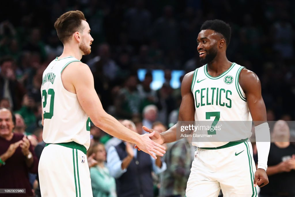 Gordon Hayward high fives Jaylen Brown of the Boston Celtics during a game against ethics's Philadelphia 76ers at TD Garden on October 16 2018 in...