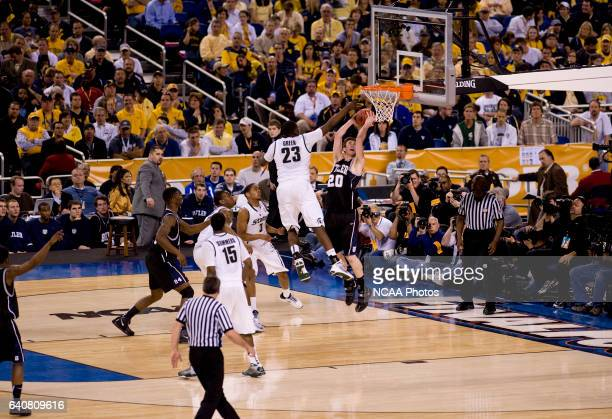 Gordon Hayward of Butler puts the ball up over Draymond Green of Michigan State during the semifinal game of the 2010 NCAA Photos via Getty Images...