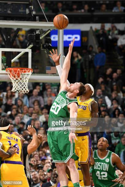 Gordon Hayward of the Boston Celtics and Kentavious CaldwellPope of the Los Angeles Lakers during a jump ball on February 7 2019 at the TD Garden in...