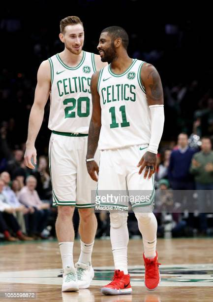 Gordon Hayward of the Boston Celtics and Kyrie Irving talk during their game against the Detroit Pistons at TD Garden on October 30 2018 in Boston...