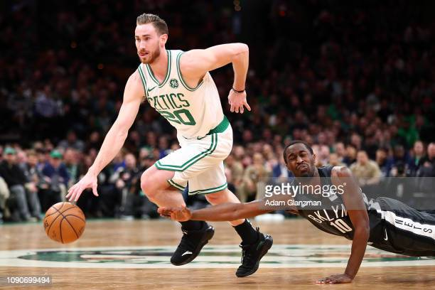 Gordon Hayward of the Boston Celtics dribbles the ball as Theo Pinson of the Brooklyn Nets lunges during a game at TD Garden on January 28 2019 in...