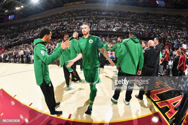 Gordon Hayward of the Boston Celtics high fives his teammates before the game against the Cleveland Cavaliers on October 17 2017 at Quicken Loans...