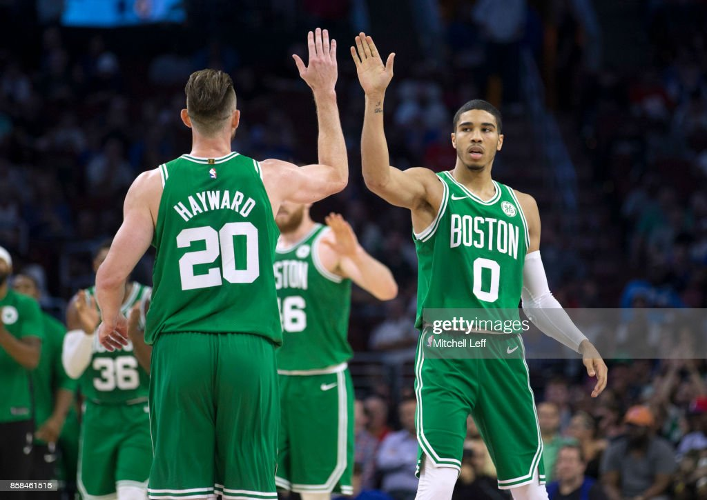 Gordon Hayward #20 of the Boston Celtics high fives Jayson Tatum #0 after a timeout in the second quarter of the preseason game against the Philadelphia 76ers at the Wells Fargo Center on October 6, 2017 in Philadelphia, Pennsylvania.