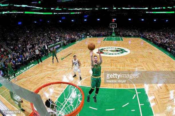 Gordon Hayward of the Boston Celtics takes a shot against the Philadelphia 76ers at TD Garden on December 12, 2019 in Boston, Massachusetts. The...