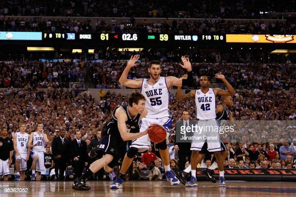 Gordon Hayward of the Butler Bulldogs pushes the ball up court for a last second shot attempt with 26 seconds left in the game against Brian Zoubek...