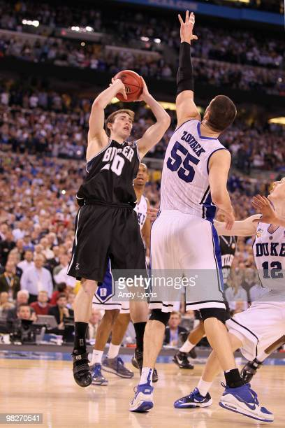 Gordon Hayward of the Butler Bulldogs shoots over Brian Zoubek of the Duke Blue Devils in the final ten seconds during the 2010 NCAA Division I Men's...