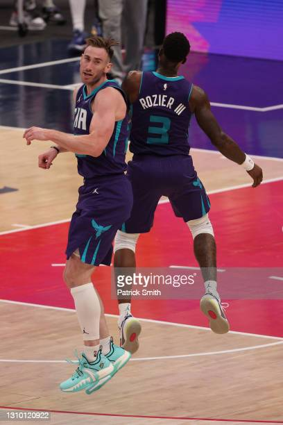 Gordon Hayward of the Charlotte Hornets and Terry Rozier celebrate against the Washington Wizards at Capital One Arena on March 30, 2021 in...
