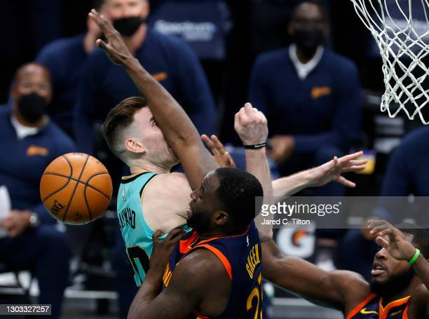 Gordon Hayward of the Charlotte Hornets attempts a shot against Draymond Green of the Golden State Warriors during the fourth quarter of their game...