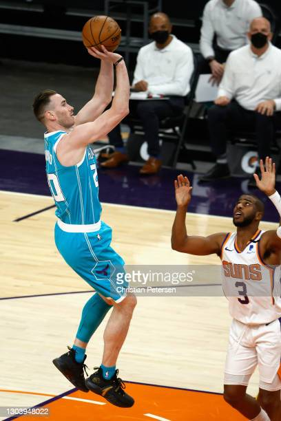 Gordon Hayward of the Charlotte Hornets attempts a shot over Chris Paul of the Phoenix Suns during the first half of the NBA game at Phoenix Suns...