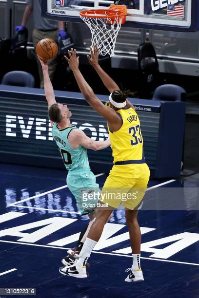 Gordon Hayward of the Charlotte Hornets attempts a shot while being guarded by Myles Turner of the Indiana Pacers in the first quarter at Bankers...