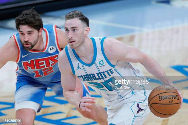 Gordon Hayward of the Charlotte Hornets dribbles as Joe Harris of the Brooklyn Nets defends during the second half at Barclays Center on April 01,...