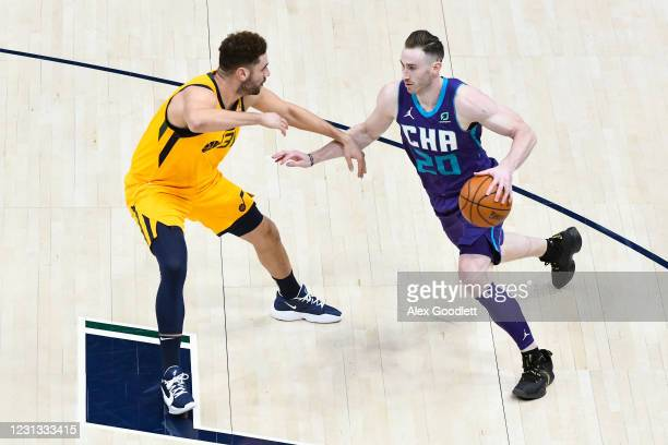 Gordon Hayward of the Charlotte Hornets drives into Georges Niang of the Utah Jazz during a game at Vivint Smart Home Arena on February 22, 2021 in...