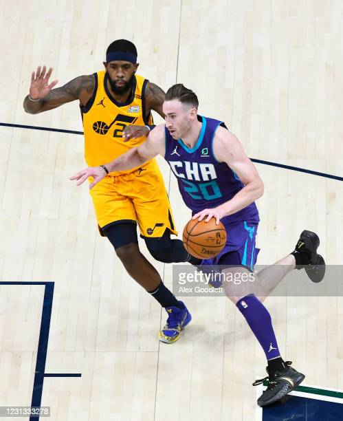 Gordon Hayward of the Charlotte Hornets drives past Royce O'Neale of the Utah Jazz during a game at Vivint Smart Home Arena on February 22, 2021 in...