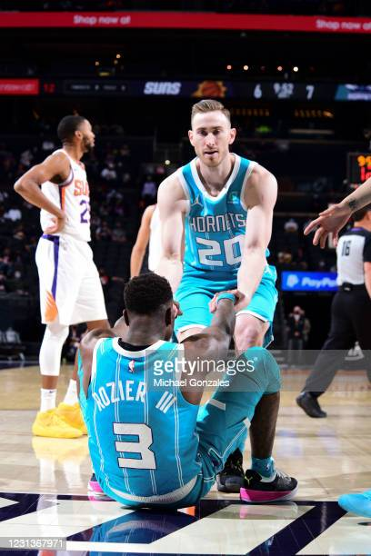 Gordon Hayward of the Charlotte Hornets helps up Terry Rozier of the Charlotte Hornets during the game against the Phoenix Suns on February 24, 2021...