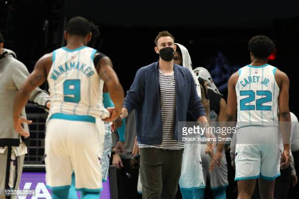 Gordon Hayward of the Charlotte Hornets high-fives teammates during the game against the Miami Heat on May 2, 2021 at Spectrum Center in Charlotte,...