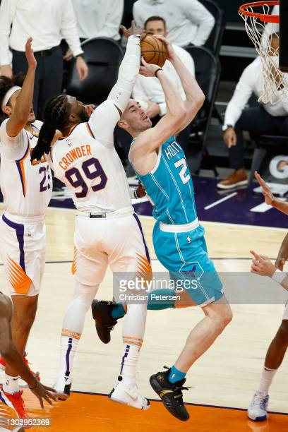 Gordon Hayward of the Charlotte Hornets is fouled as he attempts a shot against Jae Crowder of the Phoenix Suns during the first half of the NBA game...