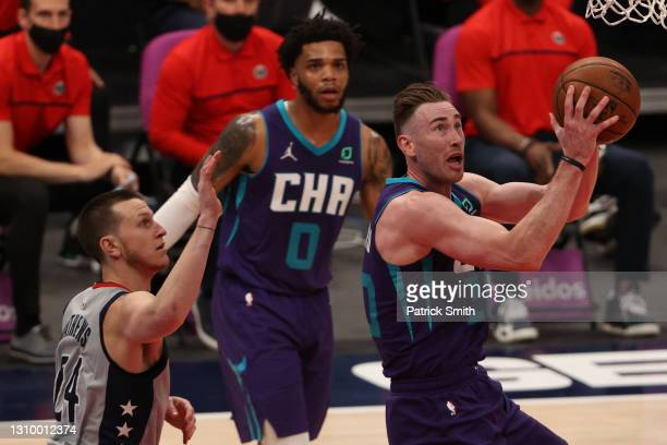 Gordon Hayward of the Charlotte Hornets shoots in front of Garrison Mathews of the Washington Wizards during the second half at Capital One Arena on...