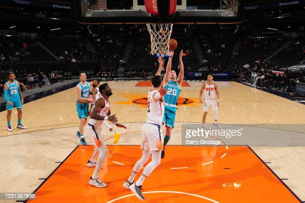 Gordon Hayward of the Charlotte Hornets shoots the ball during the game against the Phoenix Suns on February 24, 2021 at Talking Stick Resort Arena...