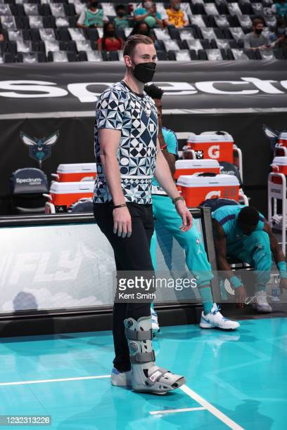 Gordon Hayward of the Charlotte Hornets stands on the sidelines during the game against the Cleveland Cavaliers on April 14, 2021 at Spectrum Center...