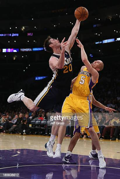 Gordon Hayward of the Utah Jazz and Steve Blake of the Los Angeles Lakers fight for a loose ball in the first half at Staples Center on October 22...