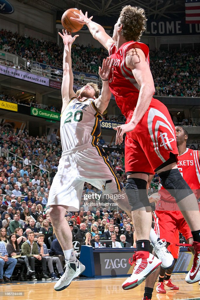 Gordon Hayward #20 of the Utah Jazz attempts a shot against Omer Asik #3 of the Houston Rockets at Energy Solutions Arena on November 19, 2012 in Salt Lake City, Utah.