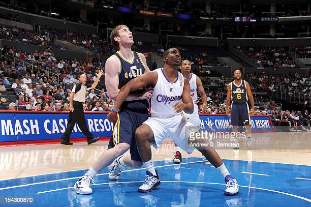Gordon Hayward of the Utah Jazz battles for position against Chris Paul of the Los Angeles Clippers during a preseason game at the Staples Center on...