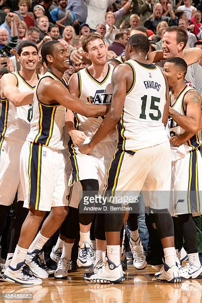 Gordon Hayward of the Utah Jazz celebrates with teammates after hitting the game winning shot against the Cleveland Cavaliers at EnergySolutions...