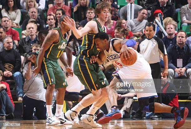 Gordon Hayward of the Utah Jazz defends against Andre Iguodala of the Philadelphia 76ers at Energy Solutions Arena on December 30 2011 in Salt Lake...