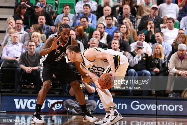 Gordon Hayward of the Utah Jazz defends the ball against the San Antonio Spurs during the game on April 5 2016 at Vivint Smart Home Arena in Salt...