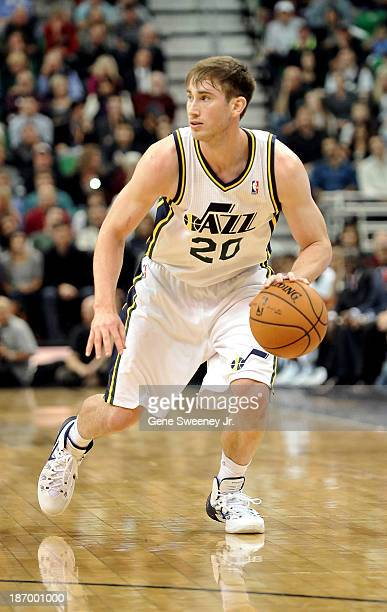 Gordon Hayward of the Utah Jazz dribbles up court during their game against the Oklahoma City Thunder at EnergySolutions Arena October 30 2013 in...