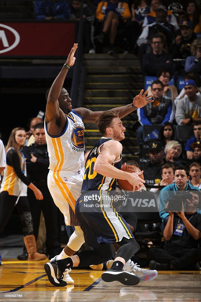 Gordon Hayward #20 of the Utah Jazz drives against Draymond Green #23 of the Golden State Warriors on November 21, 2014 at Oracle Arena in Oakland, California.