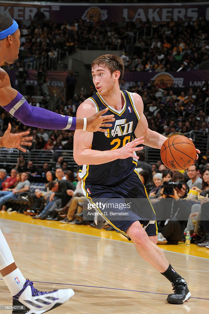 Gordon Hayward #20 of the Utah Jazz drives to the basket against the Los Angeles Lakers at Staples Center on January 25, 2013 in Los Angeles, California.