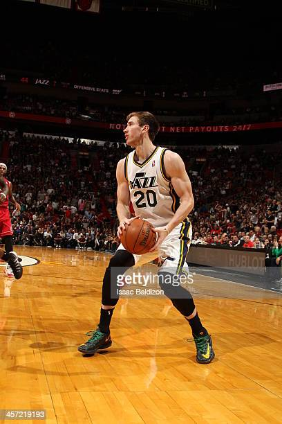 Gordon Hayward of the Utah Jazz drives to the basket against the Miami Heat on December 16 2013 at American Airlines Arena in Miami Florida NOTE TO...