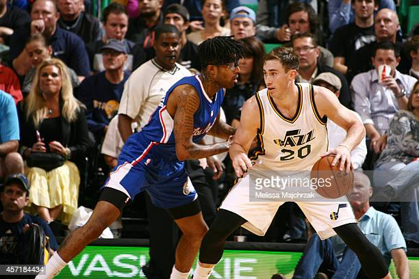 Gordon Hayward of the Utah Jazz faces Chris DouglasRoberts of the Los Angeles Clippers at EnergySolutions Arena on October 13 2014 in Salt Lake City...